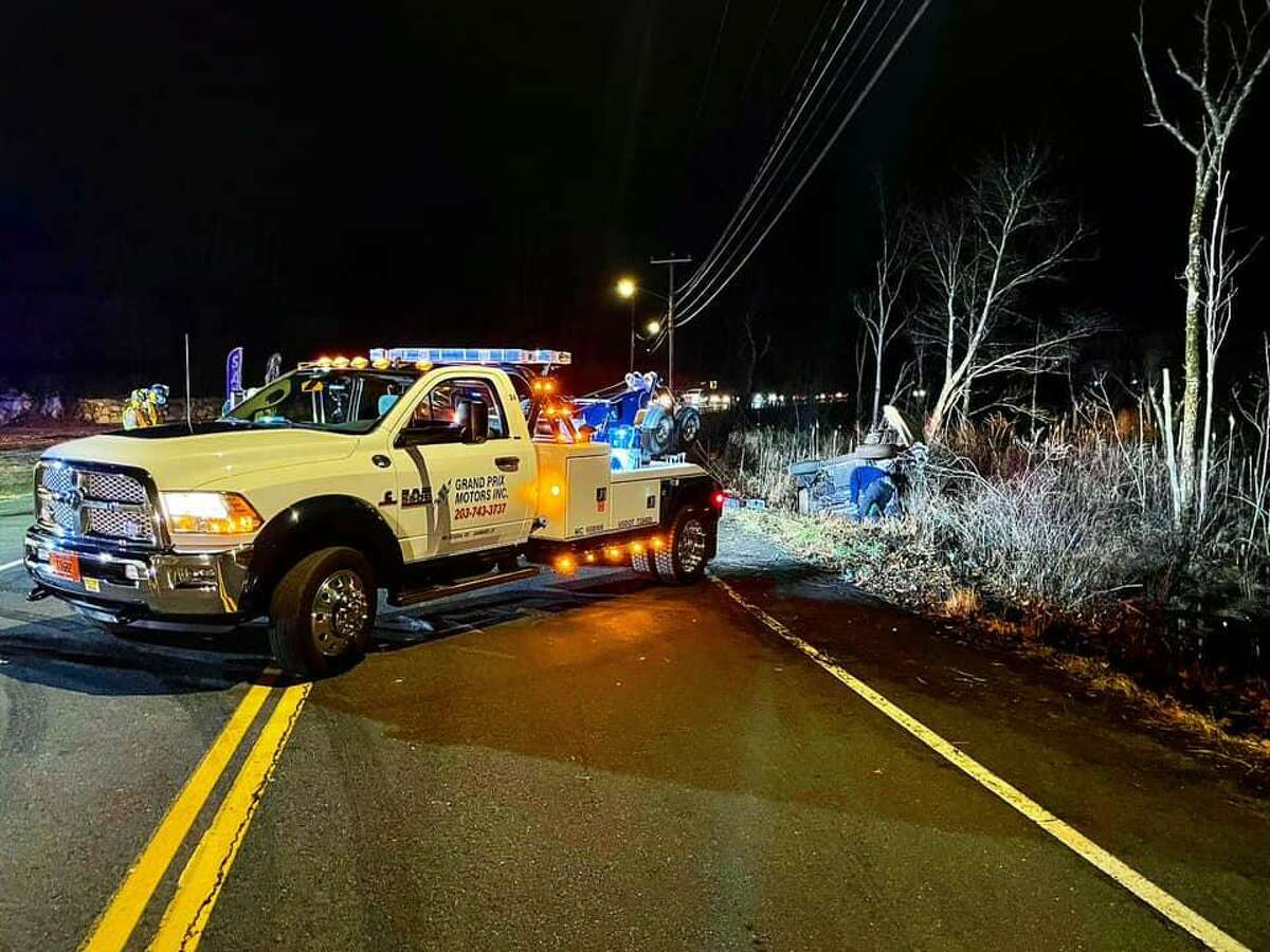 Grand Prix Motors removes an overturned car from marsh following a Route 7 crash the night of Jan. 16, 2021.