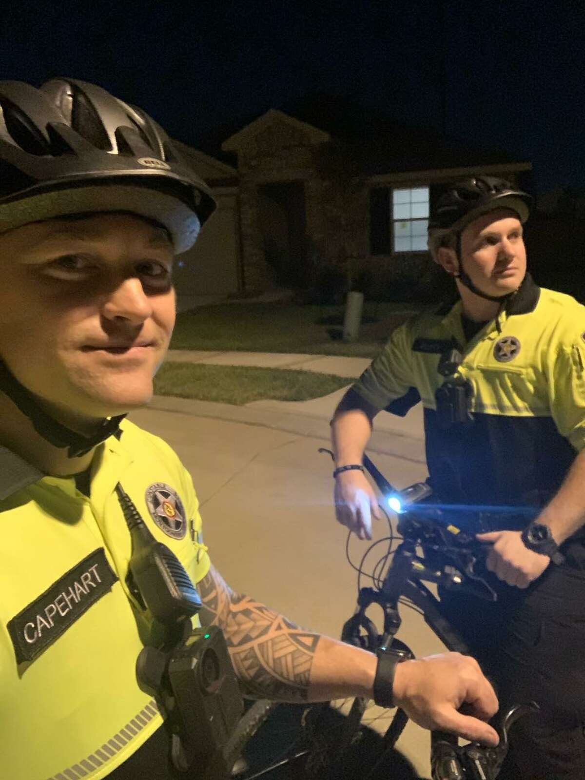 A pair of Montgomery County Precinct 4 Constable's deputies on bike patrol in an east county subdivision pose for a photo.