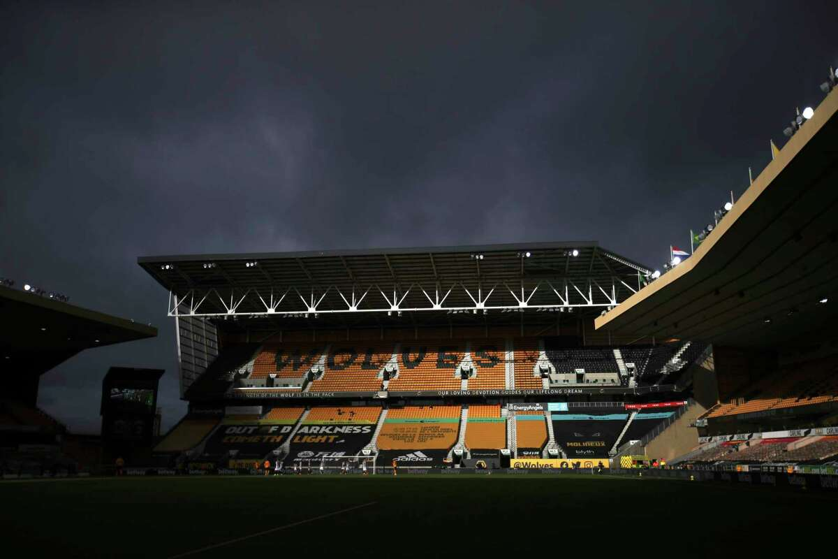 View of the empty stands during the English Premier League soccer match between Wolverhampton Wanderers and West Bromwich Albion at the Molineux Stadium in Wolverhampton, England, Saturday, Jan. 16, 2021. (Carl Recine/Pool via AP)