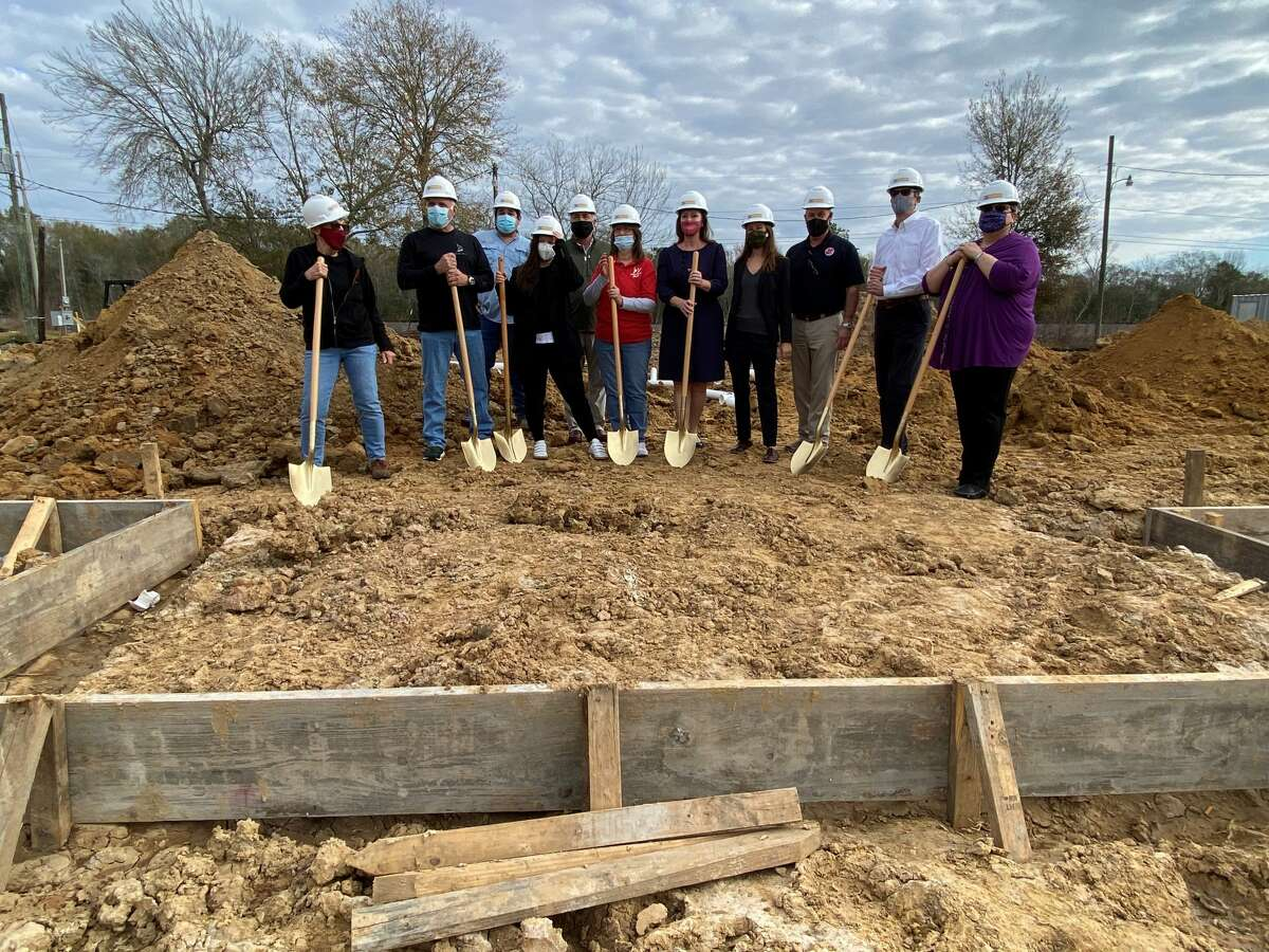 Humane Society of Southeast Texas board members and others gather for a groundbreaking ceremony at the site of the new shelter. The facility is scheduled to be completed in November. Kim Brent / The Enterprise
