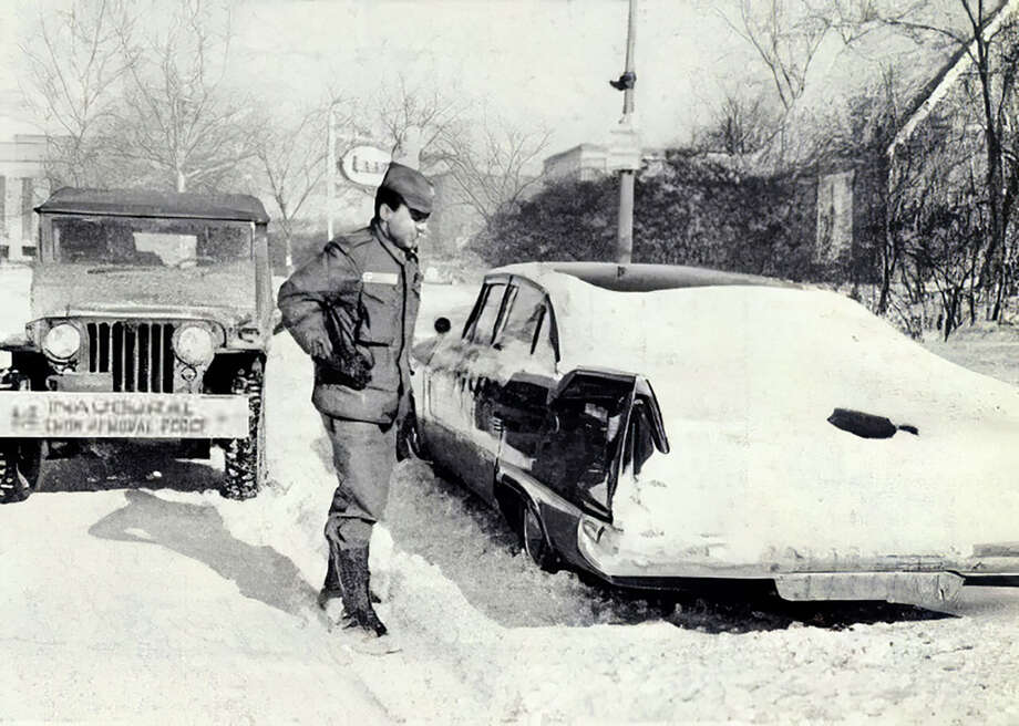 A member of the U.S. Army Corps of Engineer's Inaugural Snow Removal Force prepares to move a car abandoned in the snowstorm on the eve of Kennedy's inauguration in 1961. Photo: U.S. Army Corps Of Engineers. / U.S. Army Corps of Engineers