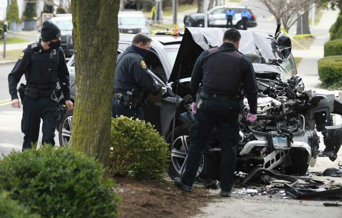 Greenwich Police examine the aftermath of a single car accident on East Elm Street in Greenwich, Conn. Tuesday, Jan. 19, 2021.