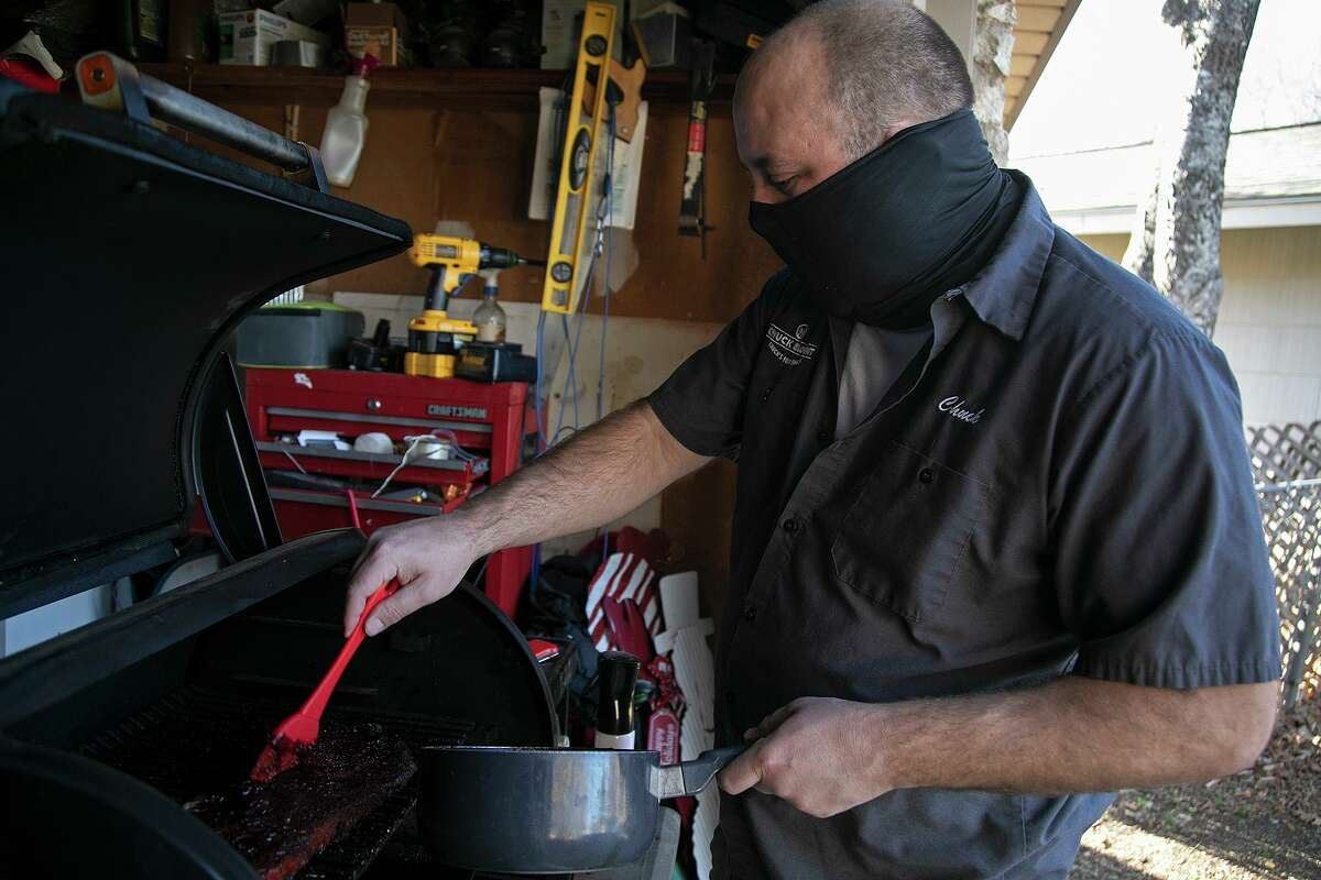 Chuck Blount bastes ribs on the smoker at his home with a glaze based with the popular Big Red soda.