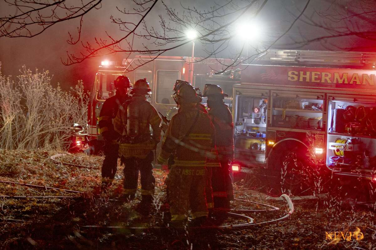 Firefighters from four towns responded to a house fire on Mary Bee Lane in Sherman, Conn., Jan. 18, 2021.