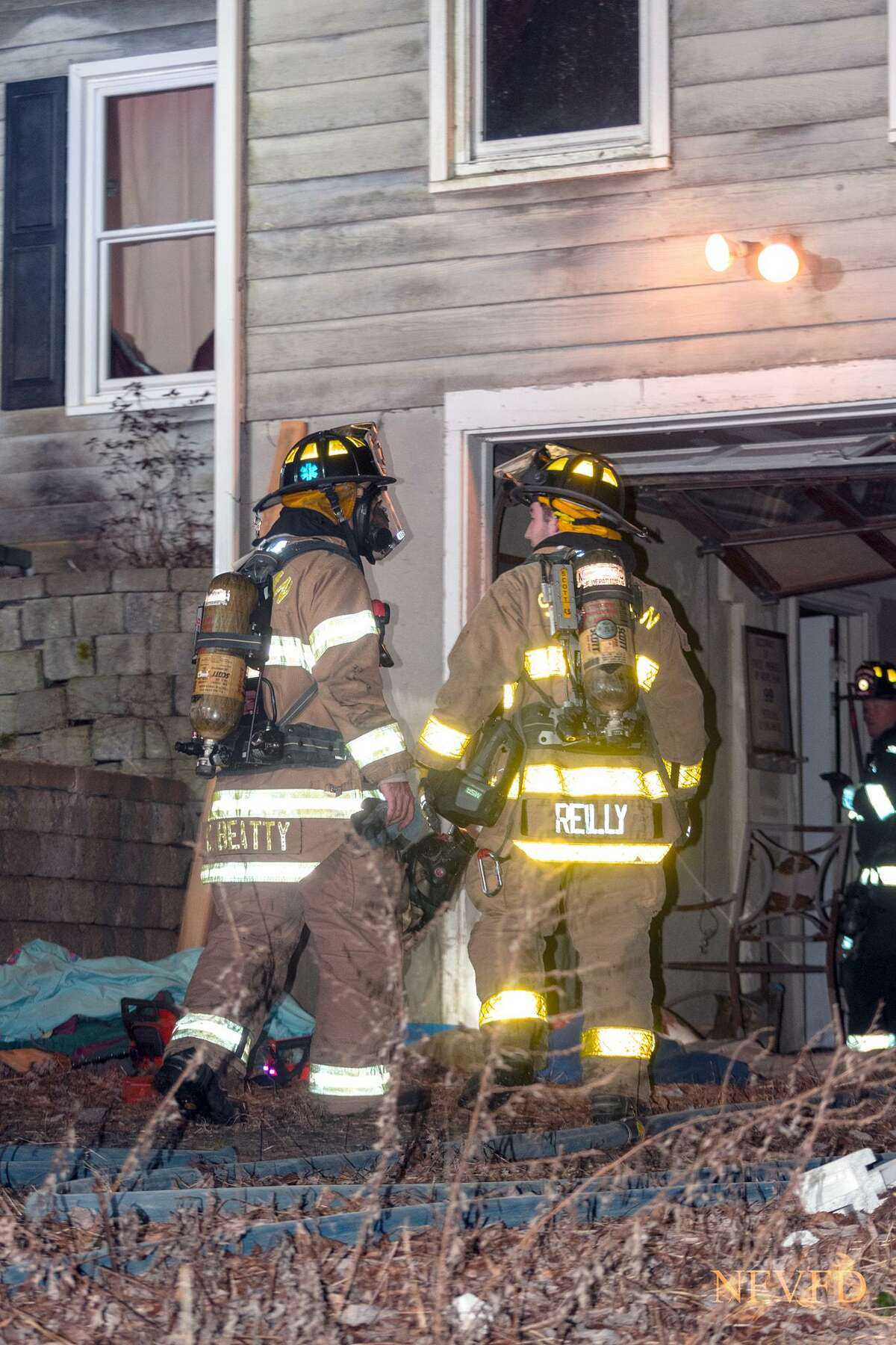 Firefighters at the scene of a house fire on Mary Bee Lane in Sherman, Conn., Jan. 18, 2021.