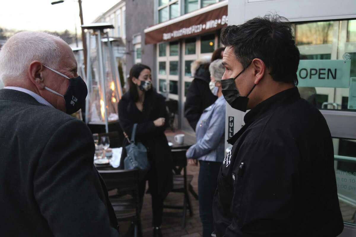 First Selectman Jim Marpe talks with Renato Donzelli, owner and chef of Basso Restaurant & Wine Bar on Monday, Jan. 18, 2021, in Westport, Conn.