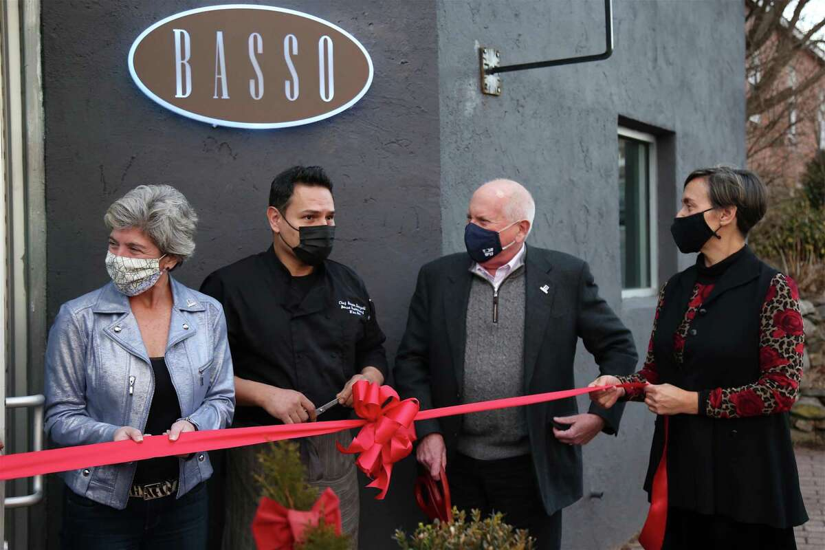 The ribbon-cutting ceremony taking place at Basso Restaurant & Wine Bar on Monday, Jan. 18, 2021, in Westport, Conn., including, from left, Second Selectman Jennifer Tooker, chef and co-owner Renato Donzelli, First Selectman Jim Marpe, and co-owner Gilda Scorza.