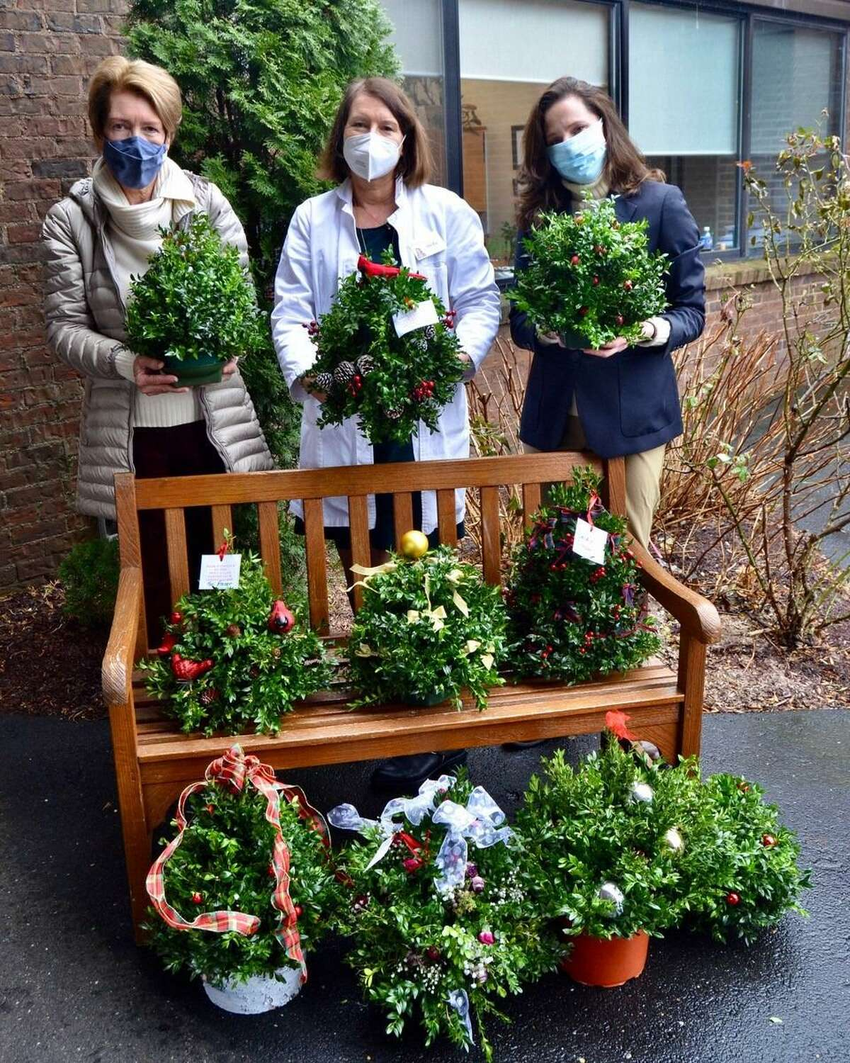 December proved to be a Season of Giving for the New Canaan Garden Club. Pictured is the donation of tabletop boxwood trees to the Waveny LifeCare Network. Pictured, left to right, are Ellen McMahon, co-chair of the club's Hort Therapy, Stella Clarke, executive director of Community Engagement and Volunteering at the Network, and Rachel Whitcomb, co-chair of the club's Hort Therapy.