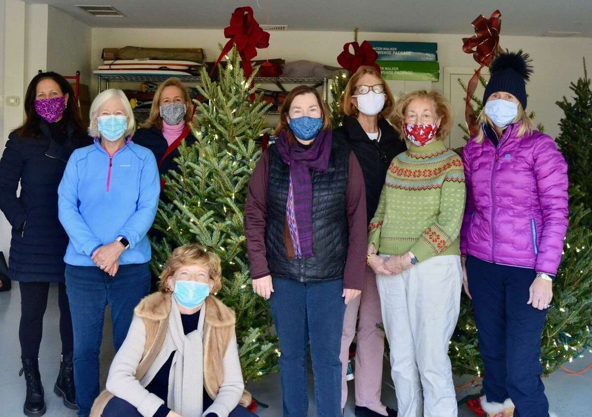 New Canaan Garden Club members decorate a tree for New Canaan Human Services. Pictured, left to right, are club President Lauren Bromberg; Molly Scott; Judy Neville, assistant treasurer of the club and chair of its Irwin Park Committee; club President Anda Hutchins; Jane Gamber; Kris Johnson; and Carrie Deane Corcoran.