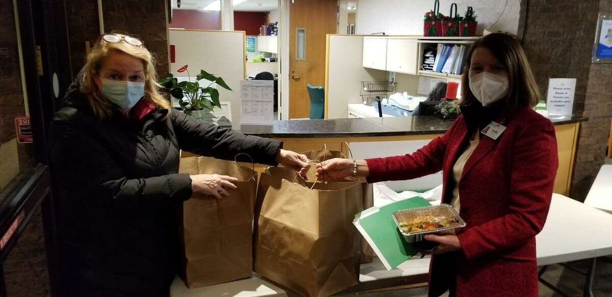 Rotary Club of New Canaan Rotarian Jane Fox recently delivered donated dinners to the Waveny Life Care Network. Pictured with Fox, right, is Stella Clarke of the Waveny LifeCare Network.