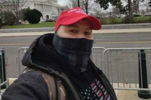 """Authorities have charged Joshua Lollar, 39, in the Wednesday, Jan. 6, 2021 insurrection at the U.S. Capitol. FBI officials say he traveled from Texas and participated in the riot, appearing to be on the """"front lines"""" of people confronting Metropolitan police trying to get into the building."""