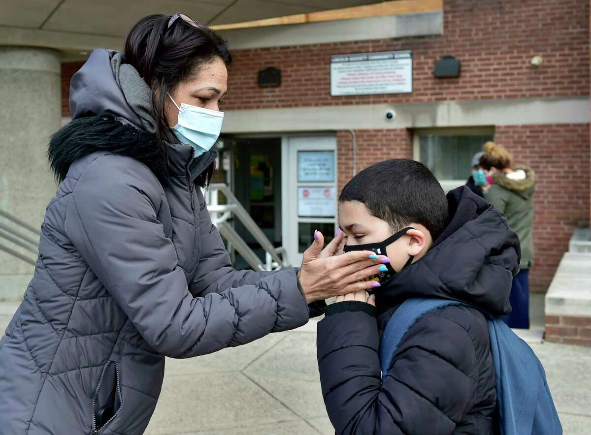 Jessica Marrero adjusts her son Jetziel's mask before Lincoln-Bassett Community School students went back to school in person on January 19, 2021.
