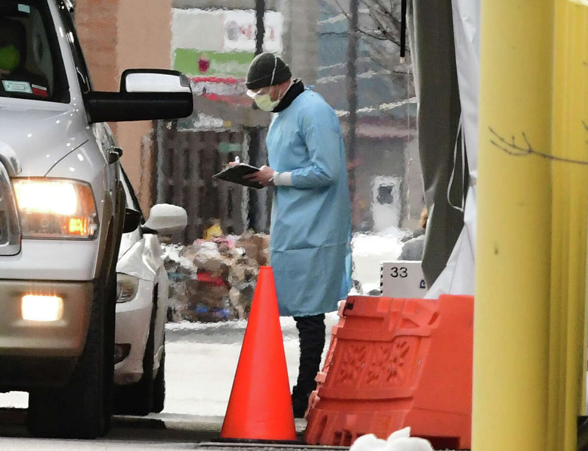 Cars are seen in the drive-through testing tent in the parking lot of an Urgent Care on Tuesday, Jan. 19, 2021 in Wilton, N.Y. (Lori Van Buren/Times Union)