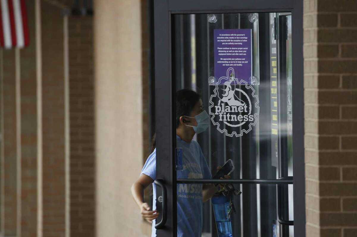 A patron enters a Planet Fitness location in Louisville, Kentucky. The chain's CEO sees virtual options becoming a permanent fixture of gyms.
