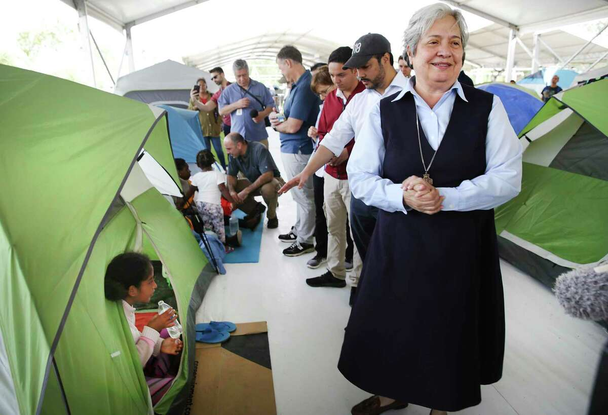Sister Norma Pimentel, right, of Catholic Charities of the Rio Grande Valley, leads a Congressional delegation, including Congressman Joaquin Castro, Chairman of the Congressional Hispanic Caucus, center across the Rio Grande to view the living conditions the asylum seekers have to deal with in the refugee camp in Matamoros, MX.