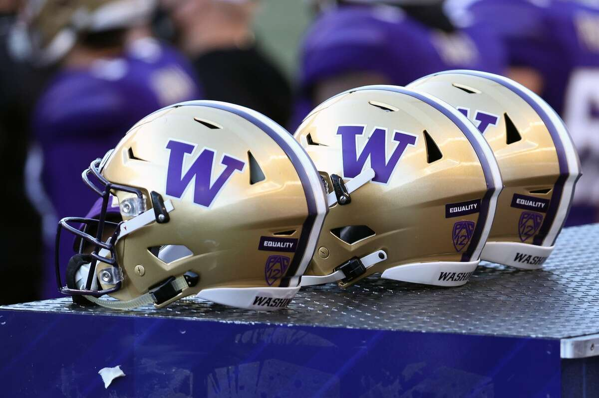 SEATTLE, WASHINGTON - DECEMBER 05: A general view of helmets worn by the Washington Huskies against the Stanford Cardinal at Husky Stadium on December 05, 2020 in Seattle, Washington. (Photo by Abbie Parr/Getty Images)