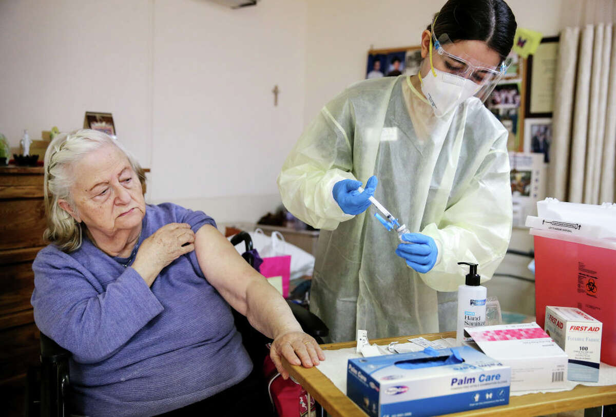 Registered nurse Arpa Davoudian prepares to administer a dose of the Moderna COVID-19 vaccine to resident Siranouche Haladjian at the Ararat Nursing Facility in the Mission Hills neighborhood of Los Angeles on January 7, 2021 in Los Angeles, California.