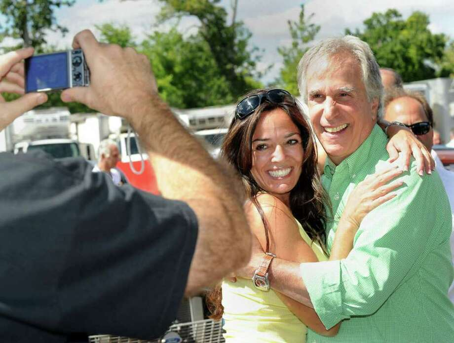 "Henry Winkler, right, who played ""The Fonz"" in the TV show, ""Happy Days"", poses for a photo with Denise Biagi of New Fairfield at the Dover Drag Strip reunion at Marcus Dairy Sunday, Sept. 5, 2010. Photo: Carol Kaliff / The News-Times"