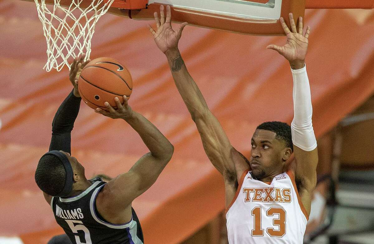 Playing his first game in nearly a year after microfracture surgery, Texas guard Jase Febres (13) impressed on defense.