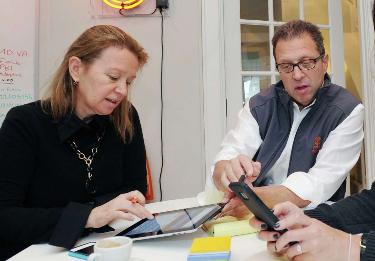 A file photo of Point Pickup Technologies CEO Tom Fiorita with Erica Ventley, chief financial officer, in the same-day delivery company's former office in Greenwich, Conn. Point Pickup took a sublease in Stamford, with Fiorita estimating it saved between 20 percent and 30 percent versus terms it would have gotten on a direct lease.