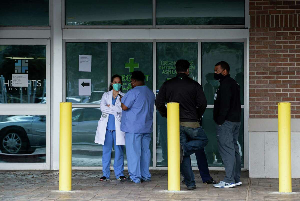 Medical staff on Monday stand outside the Heights Hospital, who were locked out without any notice.