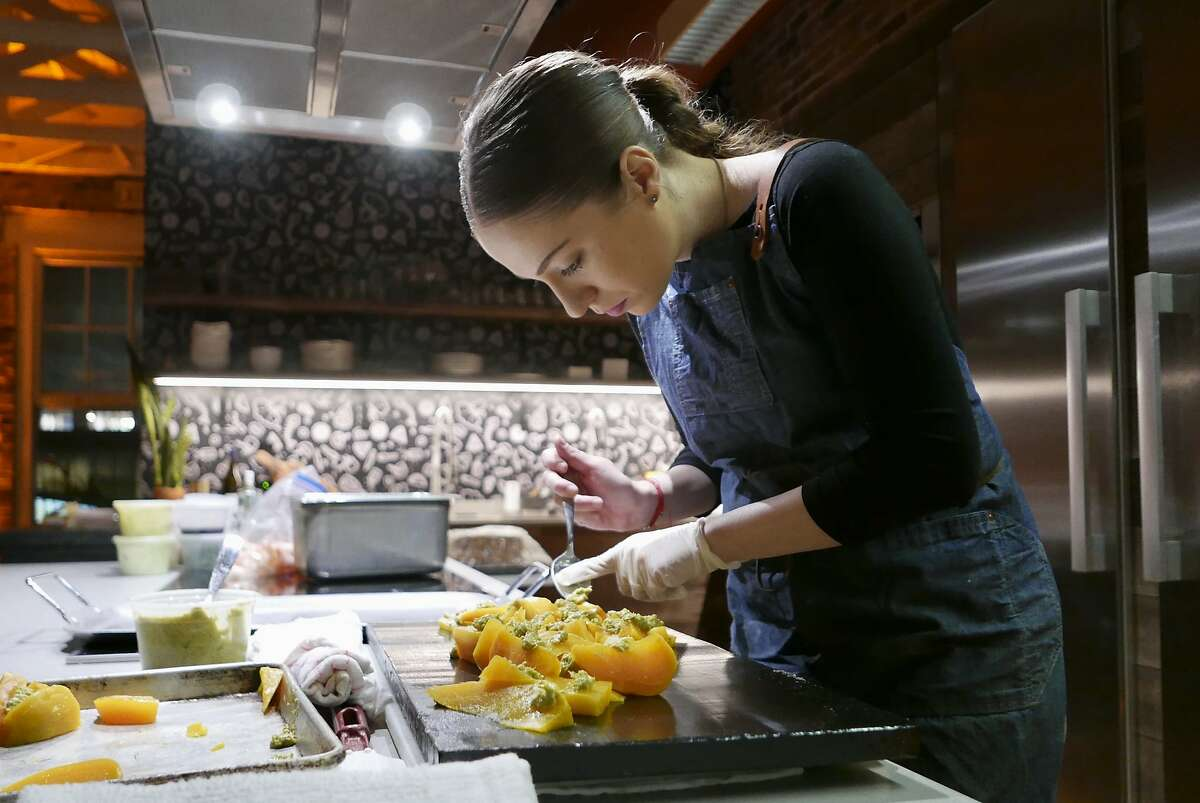 Nicole Marin prepares a dish for her Baja Mexican pop-up, Hermanita, in 2019. After working in restaurants for years and seeing the pandemic unfold, Marin is no longer interested in opening her own brick-and-mortar.