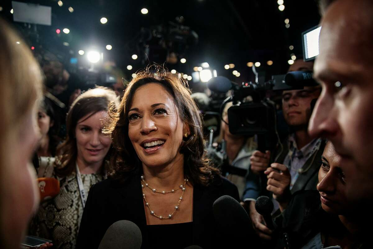 Kamala Harris is shown speaking to reporters in the spin room after the first Democratic primary debate in Miami last June.