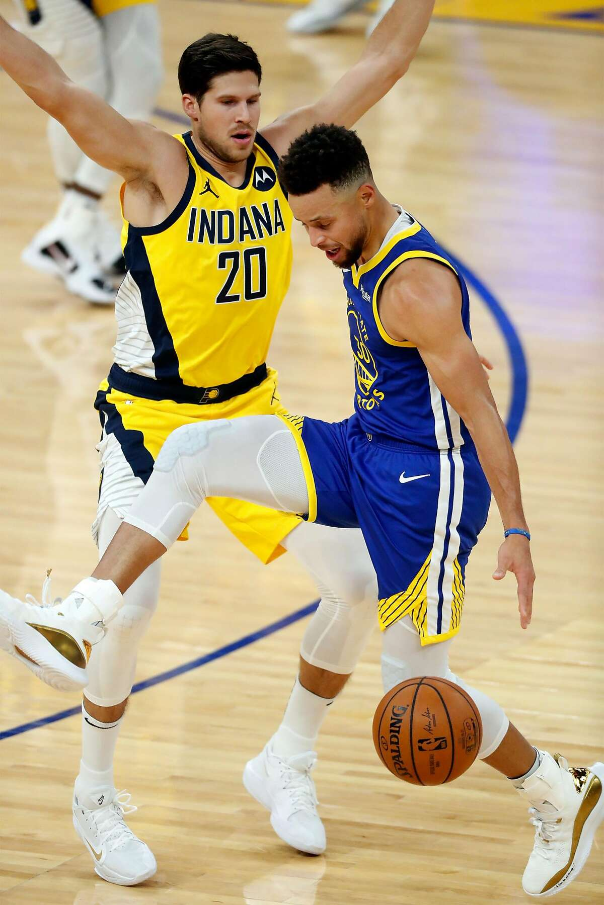 Golden State Warriors' Stephen Curry loses the ball after being fouled by Indiana Pacers' Doug McDermott in 1st quarter during NBA game at Chase Center in San Francisco, Calif., on Tuesday, January 12, 2021.