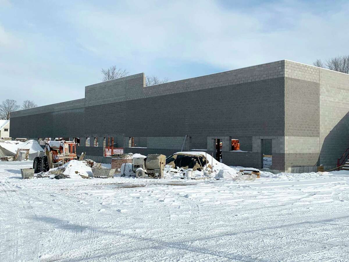 Construction on the new Ebels grocery store in Reed City progresses as the walls and the roof are completed. Construction of the interior is set to begin this week. The projected February opening has been delayed until May or June. (Pioneer file photo)