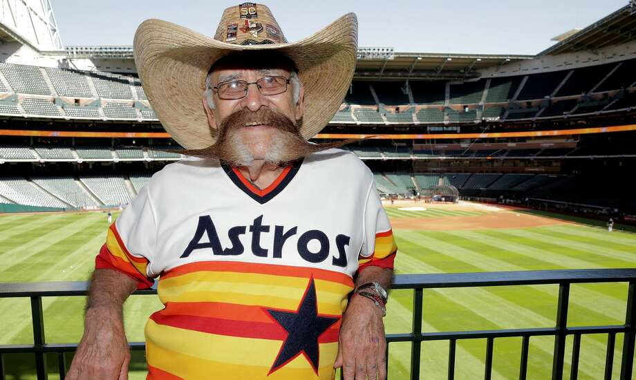 Valentin Jalomo poses for a photo in the outfield before Opening Day at Minute Maid Park on Monday, April 3, 2017, in Houston. Jalomo has attended opening days since 1965. ( Elizabeth Conley / Houston Chronicle ) Photo: Elizabeth Conley/Houston Chronicle / © 2017 Houston Chronicle