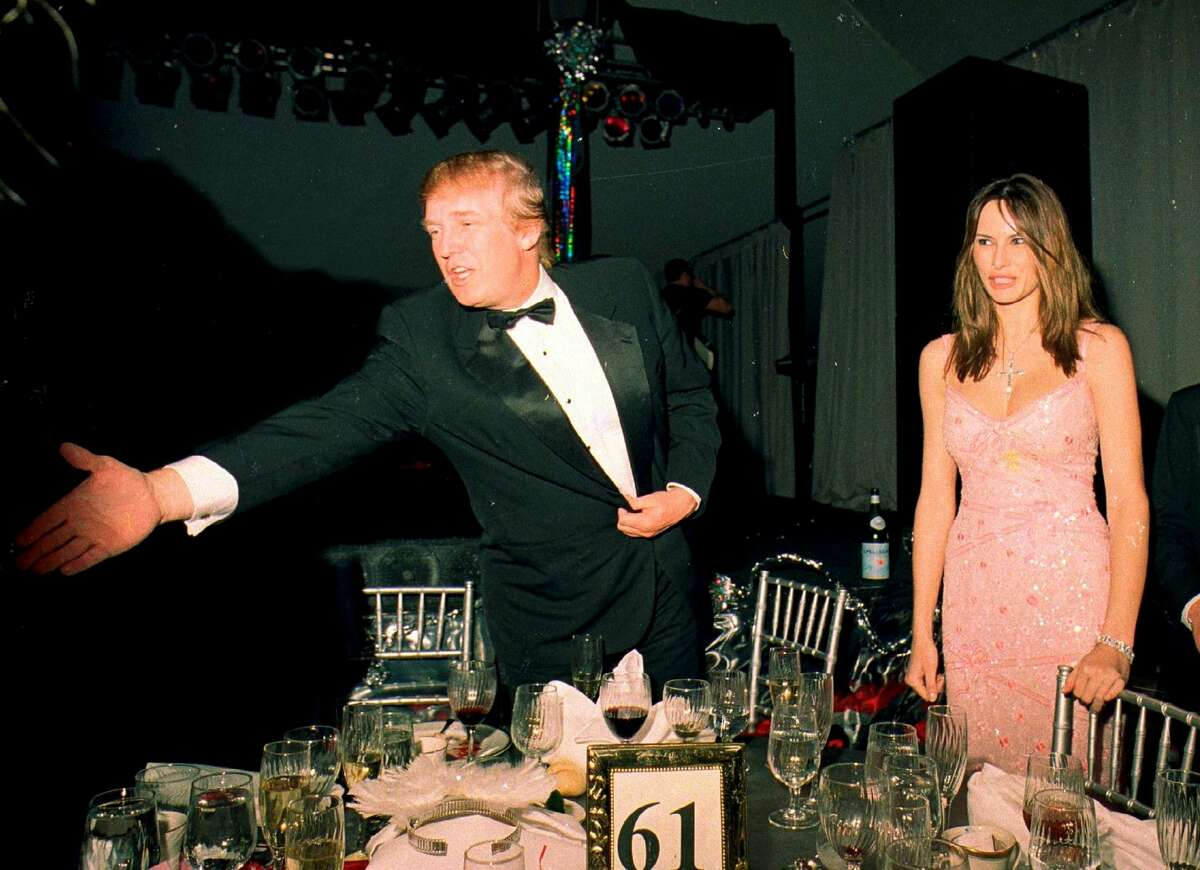 Donald Trump and his girlfriend (and future wife) Melania Knaussgreet guests during a New Year's event at Mar-a-Lago on Dec. 31, 2000.