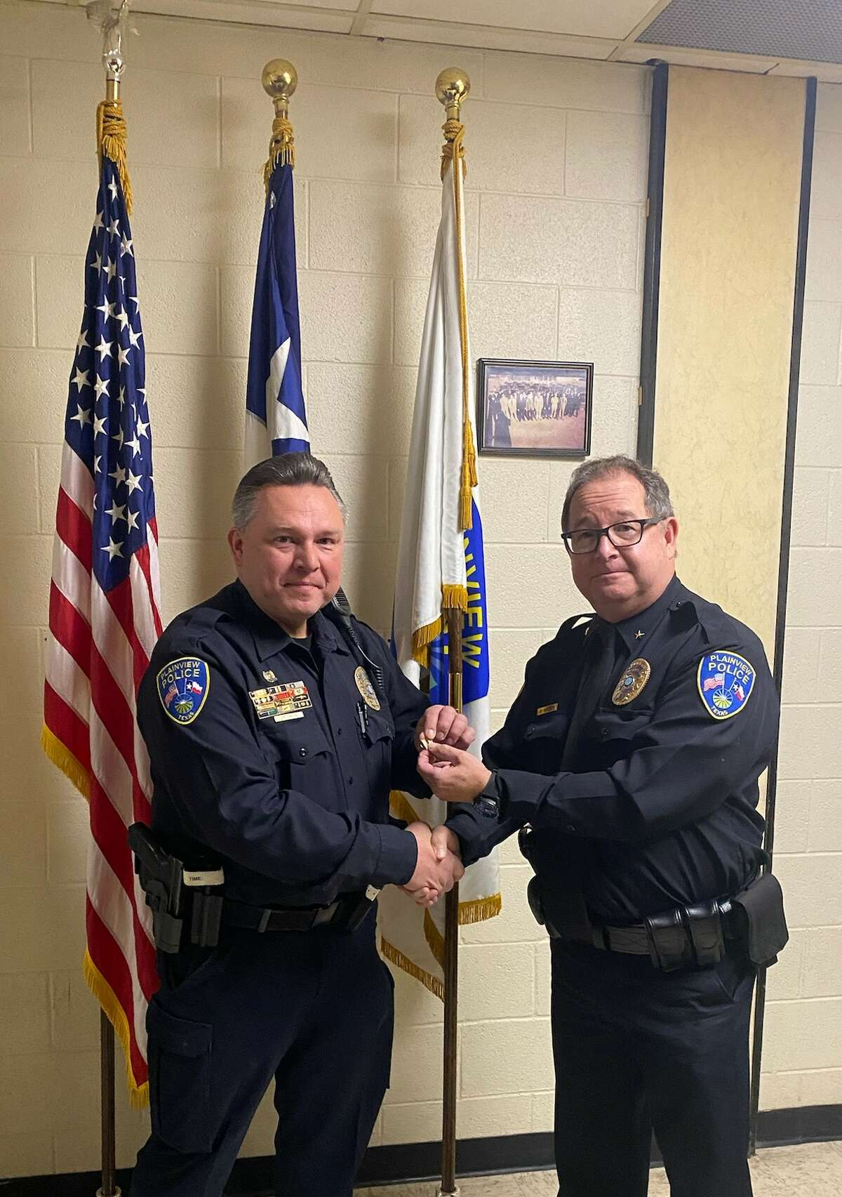Captain Bill Bridgwater stands with Chief Derrick Watson during a special recognition. Bridgwater was promoted to Patrol Captain.