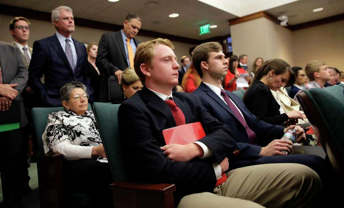 Jacob Hale, 17, center, waits to testify at the Texas Capitol in support of a bill before the House State Affairs committee to renew his effort to eliminate a state holiday honoring Confederate heroes with new backing from a high-powered lobbying firm, Wednesday, April 17, 2019, in Austin, Texas. Hale says it is important to remember the past in an accurate, truthful way that reflects Texas' values. (AP Photo/Eric Gay)