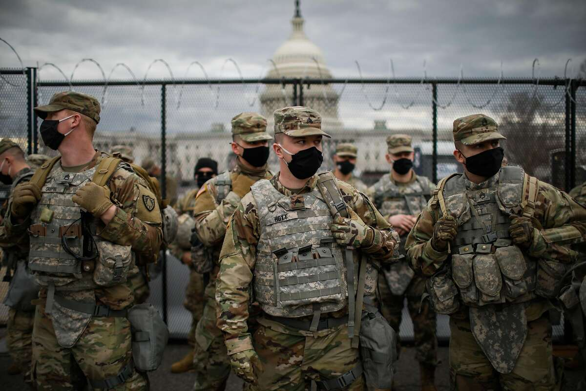Members of the National Guard take a break while providing security at the U.S. Capitol ahead of the Presidential inauguration on Sunday, Jan. 17, 2021 in Washington, D.C.