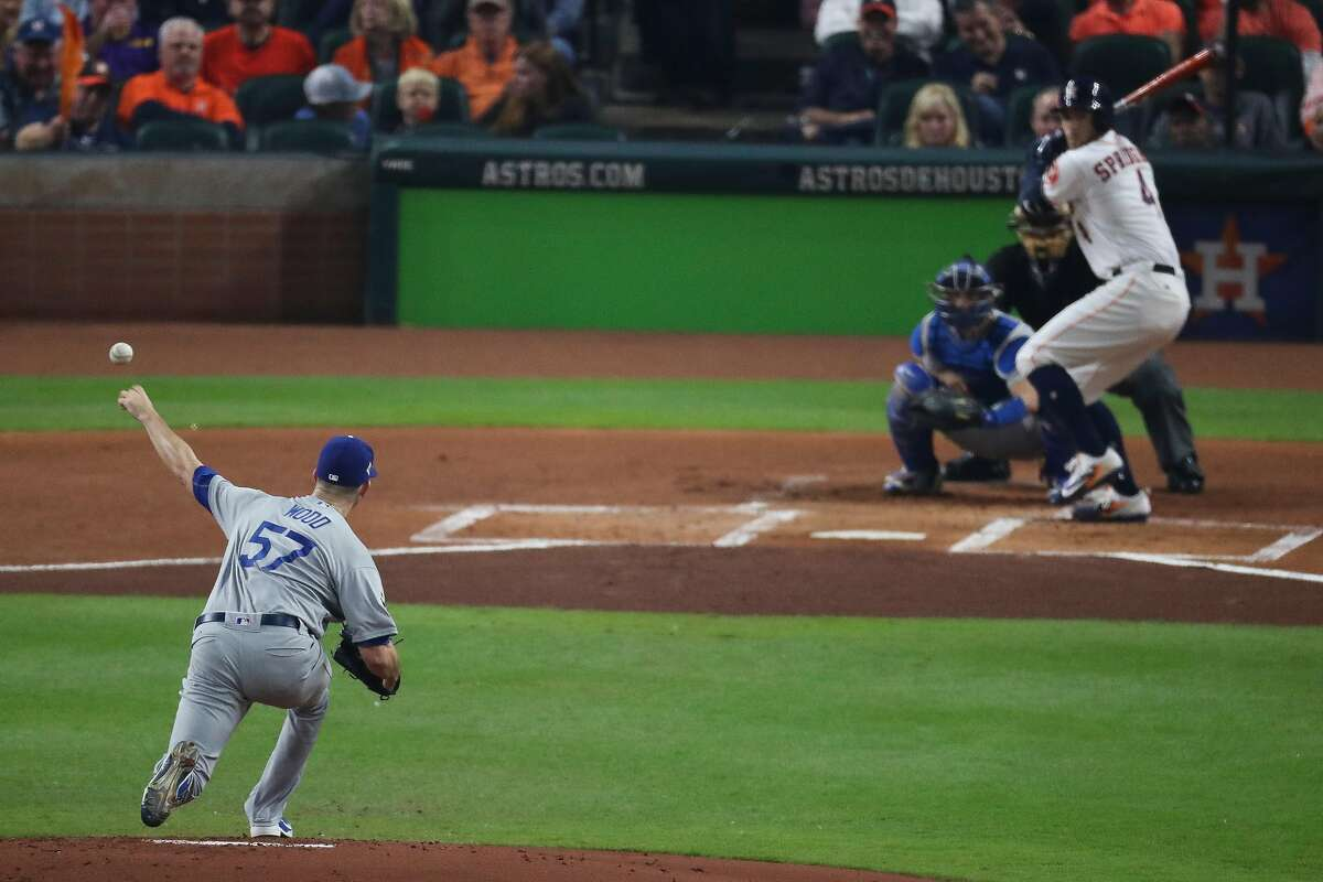 Los Angeles Dodgers starting pitcher Alex Wood (57) pitches to Houston Astros center fielder George Springer (4) during the first inning as the Houston Astros take on the Los Angeles Dodgers in Game 4 of the World Series at Minute Maid Park Saturday, Oct. 28, 2017 in Houston.