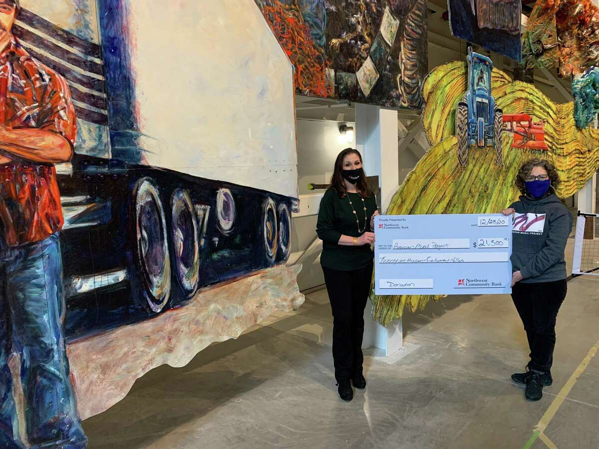 Solidea Petruzzello, vice president, branch manager of Northwest Community Bank and a member of AMP's board of directors, presented a $21,500 check to AMP Executive Director Amy Wynn.