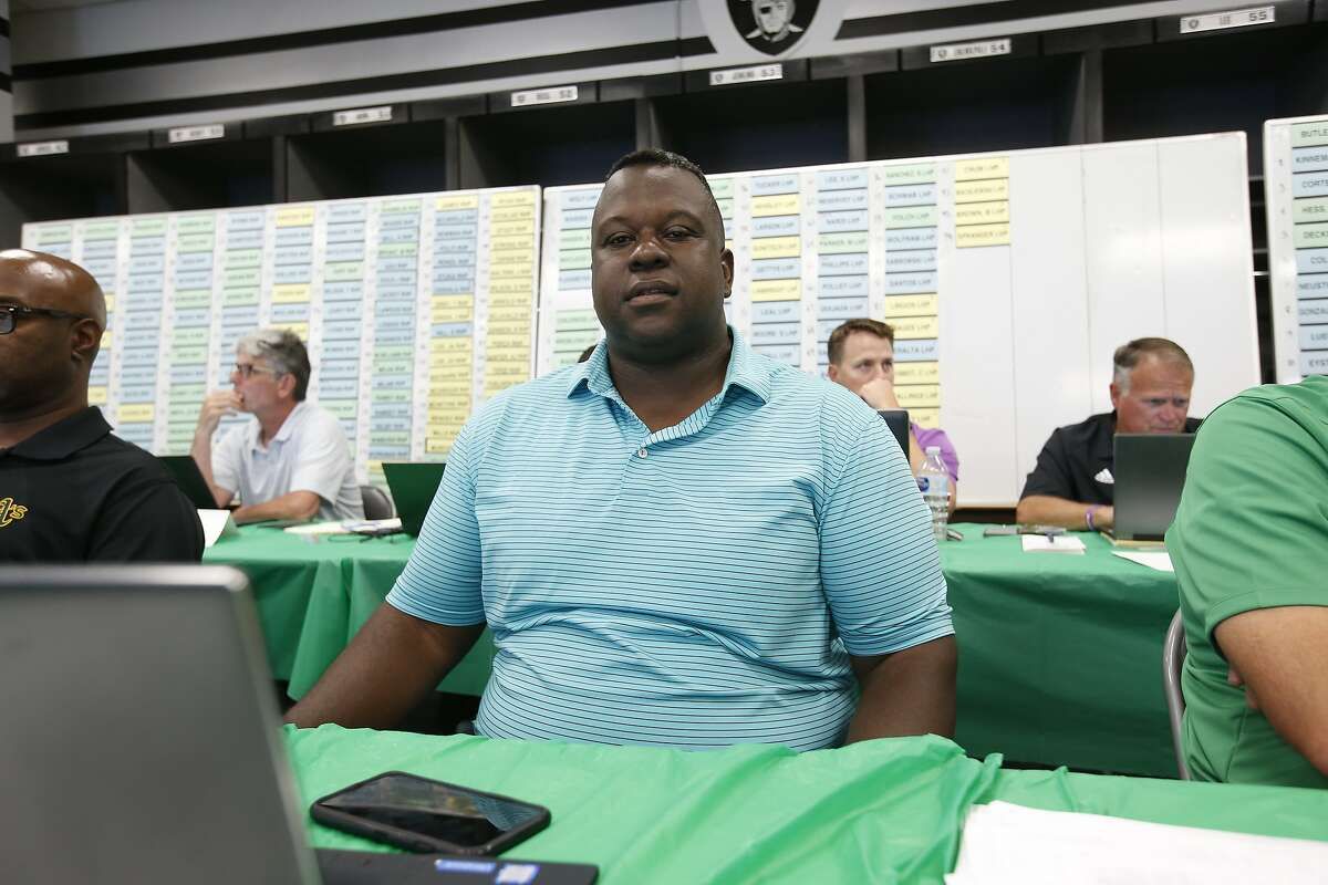 Assistant General Manager/Director of Player Personnel Billy Owens of the Oakland Athletics sits in the Athletics Draft Room on the opening day of the 2018 MLB Draft at the Oakland Alameda Coliseum on June 4, 2018 in Oakland, California.