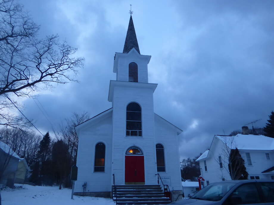 The Old Kirke Museum in Manistee tolled its church bell Tuesday as part of a nationwide moment of unity and remembrance for those who died from COVID-19. Photo: Scott Fraley/News Advocate