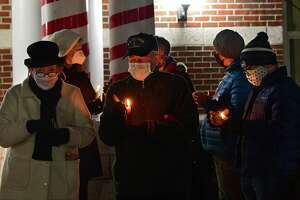 People participate in an inauguration eve COVID-19 memorial candlelight vigil outside Niskayuna Town Hall on Tuesday, Jan. 19, 2021 in Schenectady, N.Y. (Lori Van Buren/Times Union)