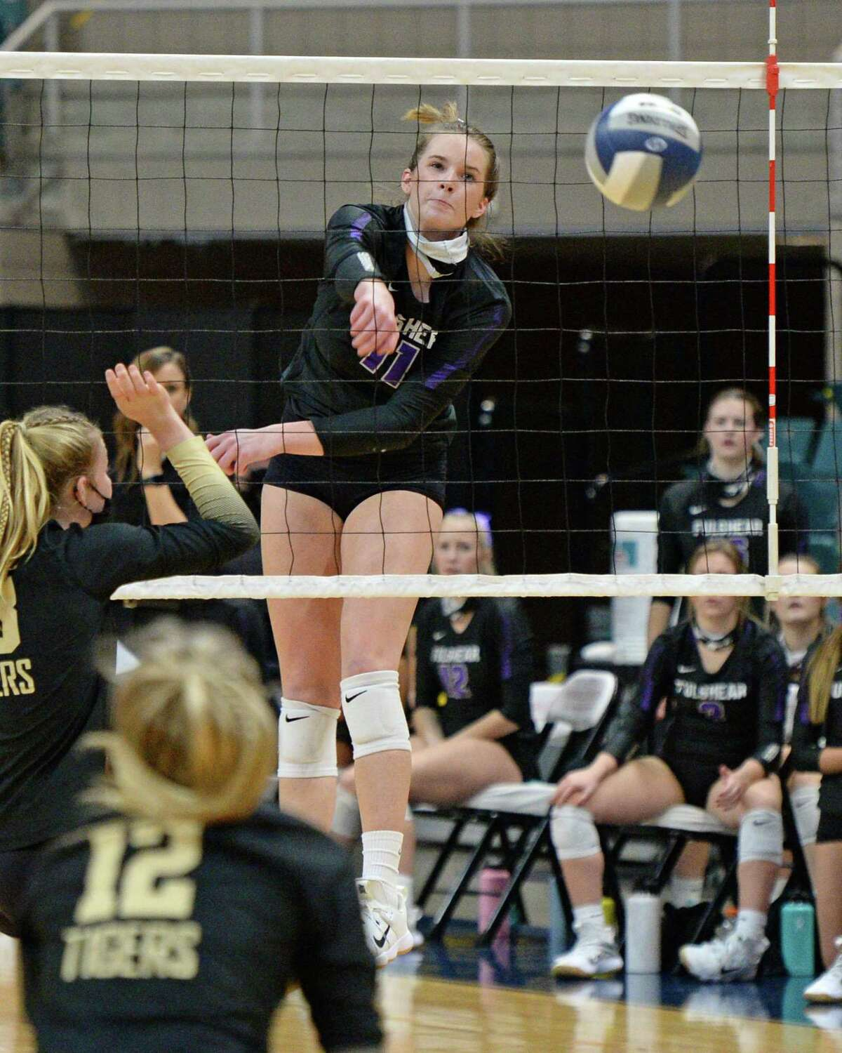 Ellie Echter (11) of Fulshear spikes a ball during the third set of the Class 5A state semifinal volleyball match between the Fulshear Chargers and the Dripping Springs Tigers. Echter was named the District 24-5A most valuable player.