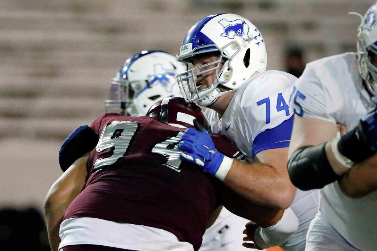 Katy Taylor offensive lineman Bryce Foster (74, a Texas A&M signee, was named to the Class 6A all-state first team by the Texas Sports Writers Association after a stellar senior season with the Mustangs.