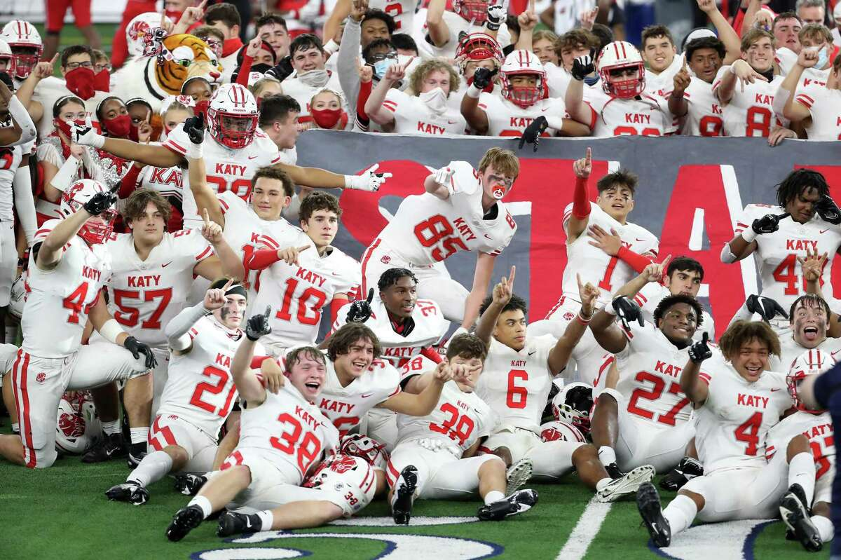 The Katy football team celebrates their 51-14 win over Cedar Hill to capture the Class 6A Division II UIL State Championship at AT&T Stadium on Saturday in Arlington.