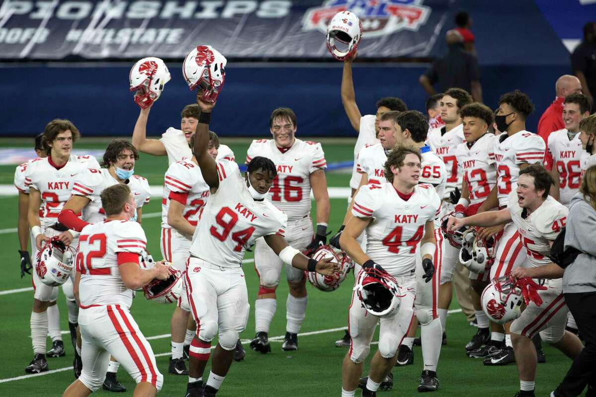 The Katy football team celebrates their 51-14 win over Cedar Hill to capture the Class 6A Division II UIL State Championship at AT&T Stadium on Saturday.