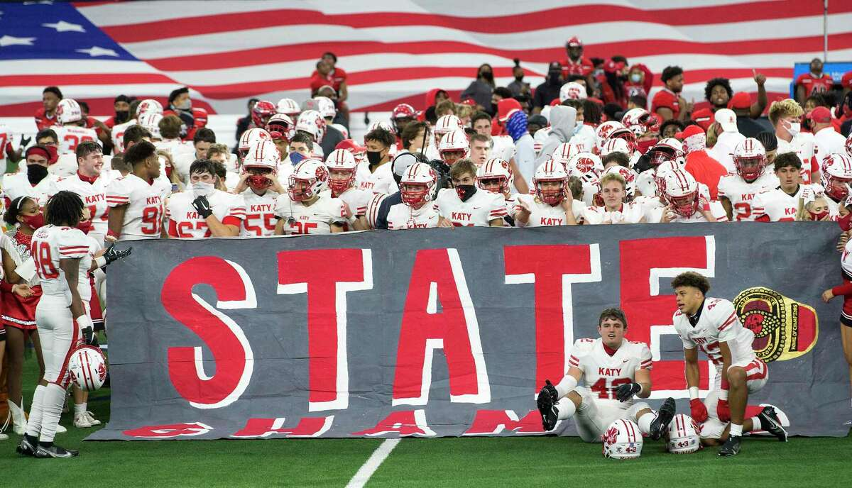 The Katy football team celebrates their 51-14 win over Cedar Hill to capture the Class 6A Division II UIL State Championship at AT&T Stadium Saturday, Jan. 16, 2021, in Arlington, Texas.