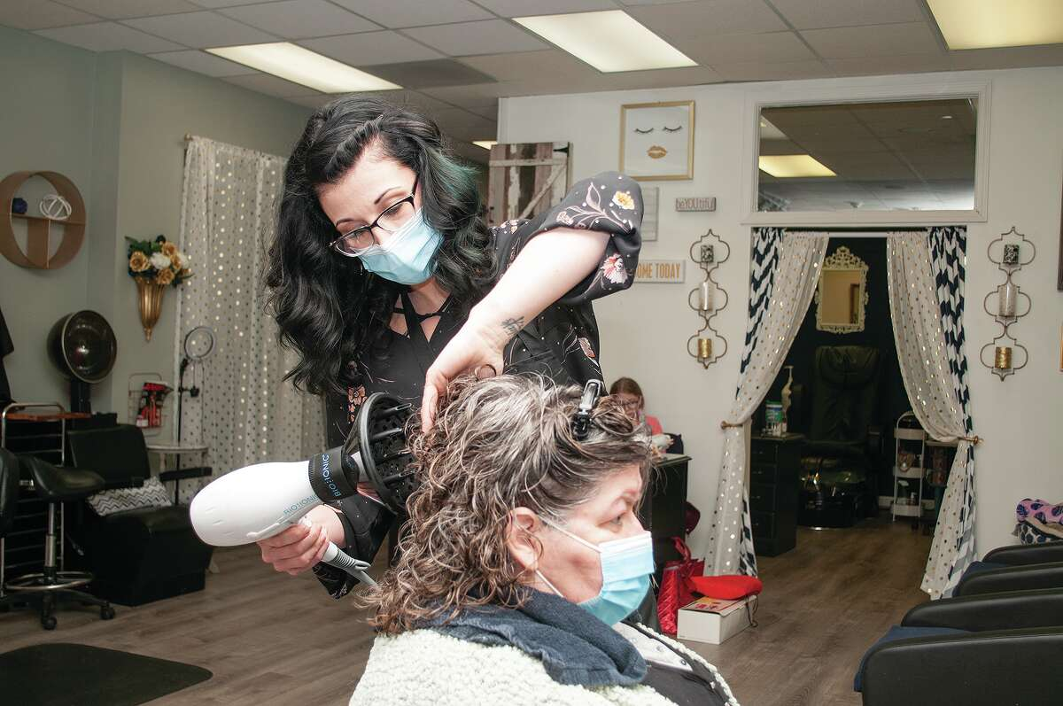 Rebekah Clark styles Sharlene Smith's hair Tuesday at A Touch of Class Salon and Spa.