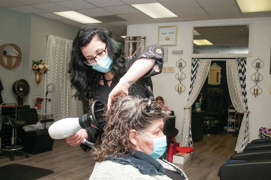Rebekah Clark styles Sharlene Smith's hair Tuesday at A Touch of Class Salon and Spa. Photo: Darren Iozia, Darren Iozia | Journal-Courier / Jacksonville Journal-Courier