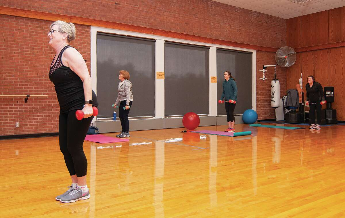 Terri Kimler instructs her class Tuesday at the Bob Freesen YMCA. With the west-central Illinois region being allowed to have indoor dining, classes and gatherings of up to 50 people, the YMCA re-started its classes. Masks are still being worn, but participants don't have to wear one while working out, only when moving from one location to another.