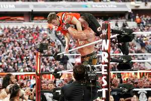 Braun Strowman tosses Saturday Night Live's Colin Jost out of the ring during WWE WrestleMania at Met Life Stadium on April 7, 2019 in East Rutherford, N.J. The 2021 WrestleMania will be held in Tampa, Fla., Stamford-based WWE has announced.