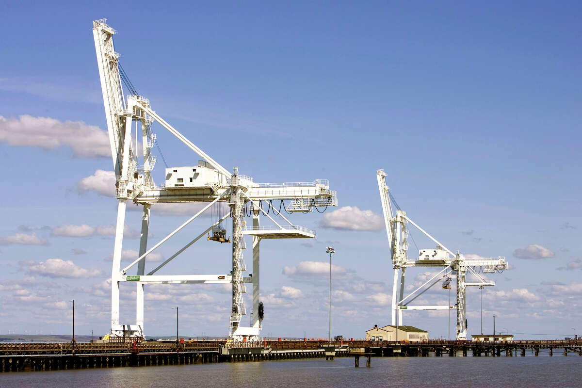 View of the giant cranes used for loading and unloading ships along the tidal area of the Concord Naval Weapons Station.