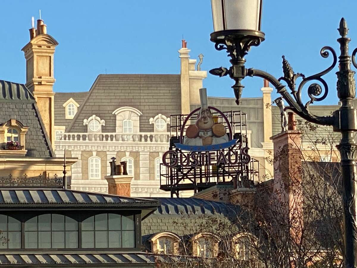 The sign over Remy's Ratatouille Adventure is for Gusteau's, the restaurant from the movie where the rat becomes a chef.